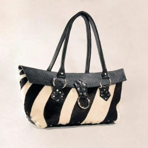 Black white hair on silver riveted purse