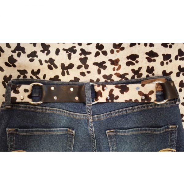 Black white hair on leather belt