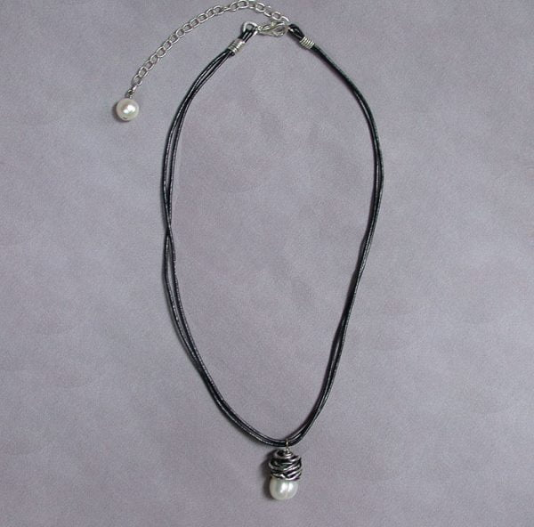Hand wrapped sterling knot with pearl necklace