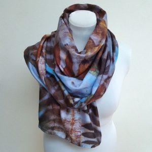 Eco printed silk scarf with black walnut on blue