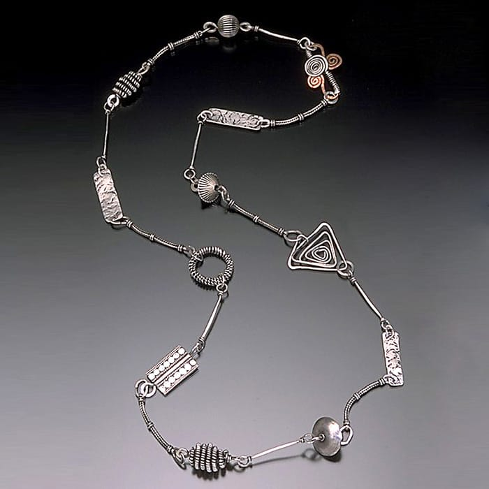 Hand wrapped long sterling silver necklace
