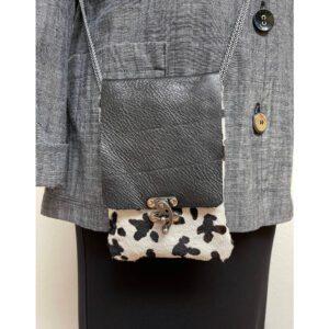Hair on black white leather cellphone bag
