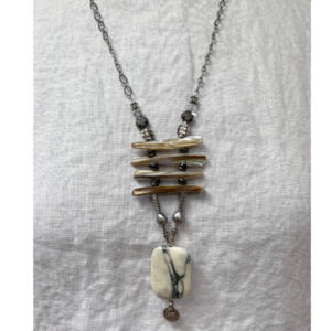 Marble pendant necklace on linen